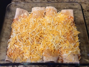 Use remaining enchilada sauce and cheese to cover enchiladas