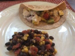 Shrimp Tacos with a side of Mexican Black Beans and Corn