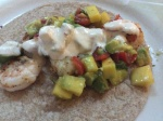 Shrimp Tacos topped with Guacamole/Mango Salsa and a Creamy Lime Sauce