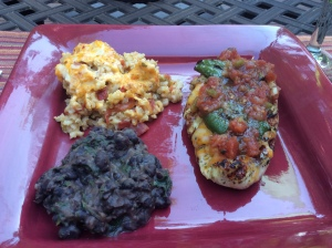 I added cheese and salsa to my dish served alongside Mexican Rice Casserole and Refried Black Beans