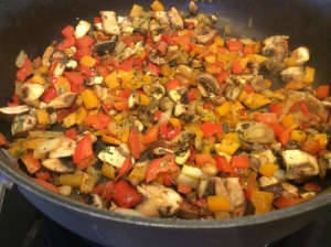 Onions, Mushrooms, and Peppers all in the pan together