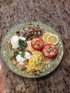 Feta Stuffed tomato as a side dish to Crab Cakes and sides of fried corn and vegetable rice pilaf