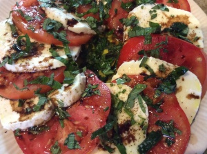 Tomato and Mozzarella Salad with Fresh Basil, Rosemary, and Basil from the garden