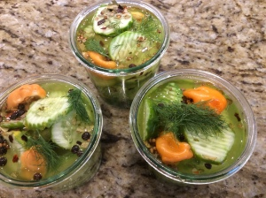 Cover pickles with vinegar and top with additional dill and chives