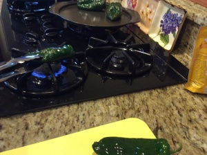 Roasting poblanos over the fire source
