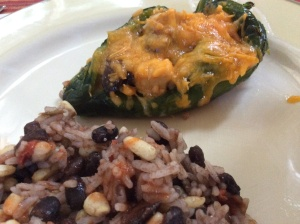 Served alongside a bed of Black Beans & Rice