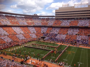 "The Big Orange running through the ""T"" in an orange and white checkered Neyland Stadium!"