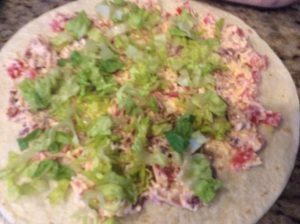 Spread a 3-4 tablespoons of the cream cheese mixture evenly over the tortillas and top with the lettuce....
