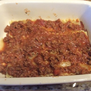 Add 3 noodles and another layer of meat sauce