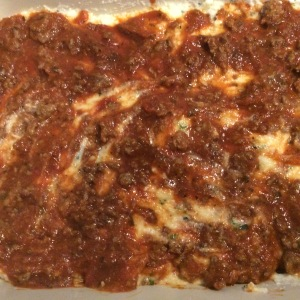 Add more meat sauce on top of ricotta mixture