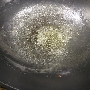 Butter melting in the wok
