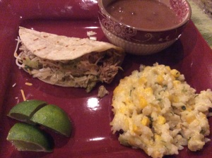 Pork Carnitas served with Mexican Pinto Beans and Sour Cream Rice
