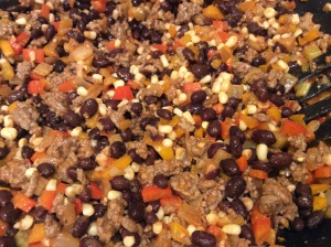 The ground beef along with the remaining ingredients are added to the pan