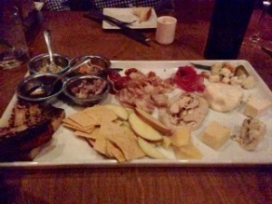 Cured meats and cheese tray with a sauce sampler