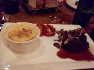 Finally, I had the Grilled Beef Tenderloin.  It came with caramelized onion mashed potatoes, with roasted tomatoes and sautéed mushroom.  The sauce next to the steak is a veal demi glas