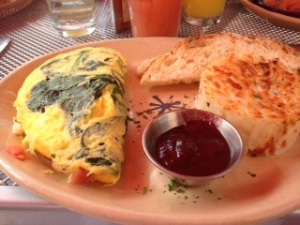 My spinach, swiss, and tomato omelet..perfectly cooked