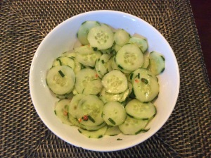 Cucumbers are added in with the sauce and it's time to marinate!