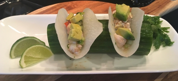 Mini Seafood Ceviche Tacos with a Jicama shell served in a cucumber boat